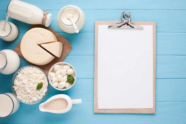 Copy space clipboard with dairy products Free Photo