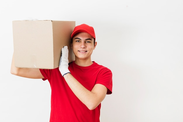 Copy-space delivery man carrying package Free Photo