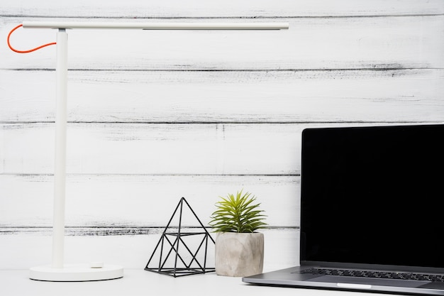 Copy space front view laptop on wooden background Free Photo