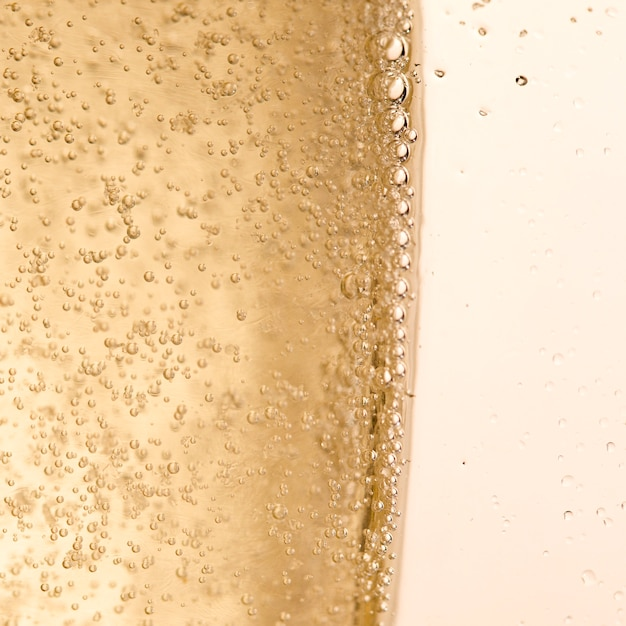 Copy-space glass with champagne bubbles Free Photo