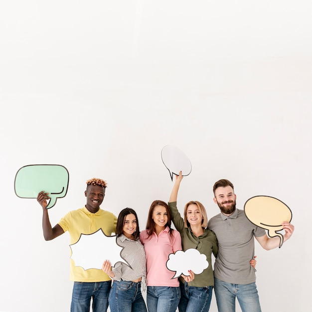 Copy-space group of friends holding chat bubble Free Photo