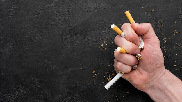 Copy-space hand with cigarettes Free Photo