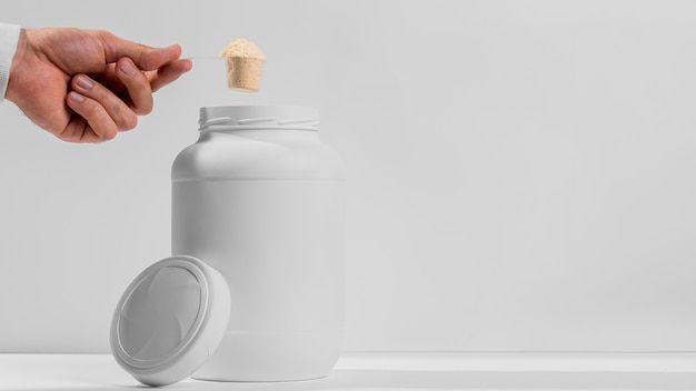 Copy-space jar with gym supplements Premium Photo
