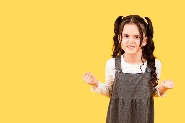 Copy-space little girl angry pose Free Photo
