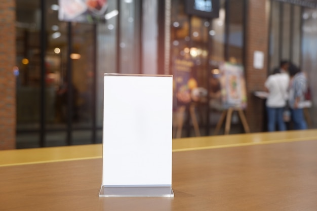Copy space menu frame on wooden table Premium Photo