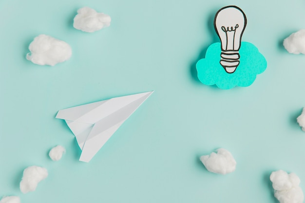 Copy-space paper light bulb and airplane Free Photo