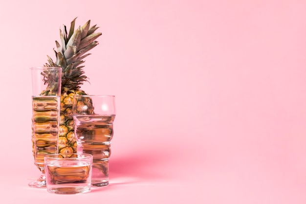 Copy space pink background pineapple Free Photo