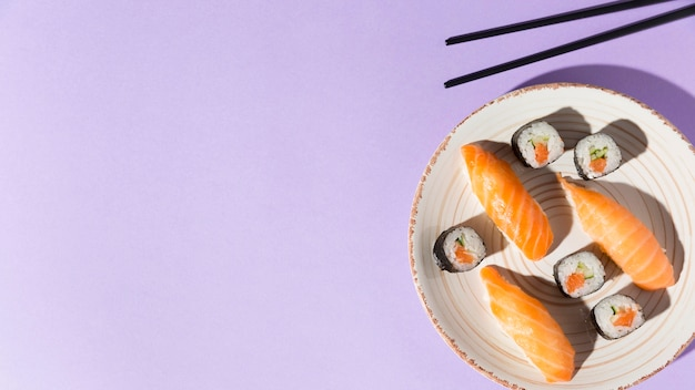 Copy-space plate with delicious variety of sushi Free Photo