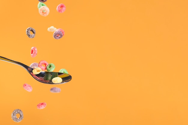Copy-space pouring cereals on spoon Free Photo