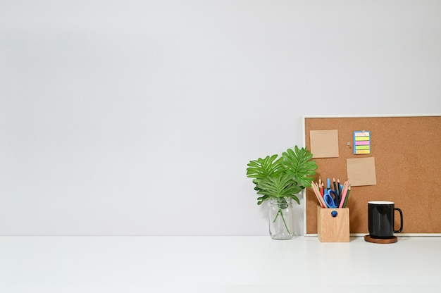 Copy space table with office supplies on workspace Premium Photo