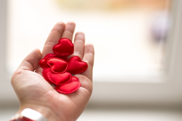 Copy space  valentine's day  little red hearts in hand on