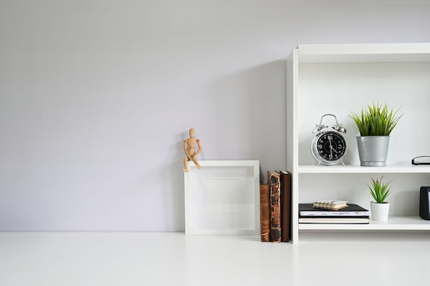 Copy space with books, alarm on white table. Premium Photo