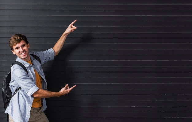 Copy-space with man pointing at background Free Photo