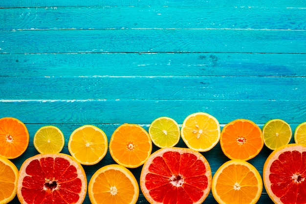 Copy-space with mixed citrusses on table Free Photo