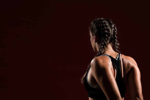 Copy space and woman in dark background from behind shot Premium Photo