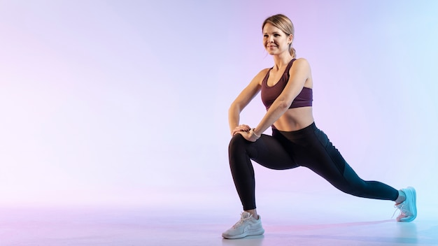 Copy-space woman stretching before work out Free Photo