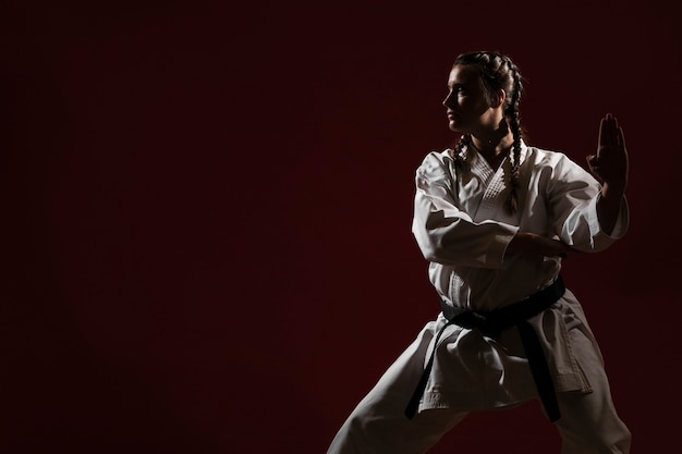 Copy space and woman in white karate uniform Free Photo