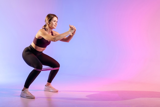 Copy-space woman working out with elastic band Free Photo