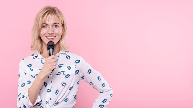 Copy-space young woman holding microphone Free Photo