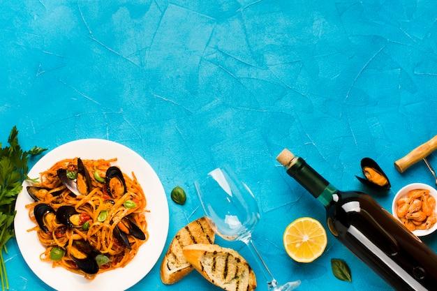 Плоские блюда из морепродуктов с copyspace Бесплатные Фотографии