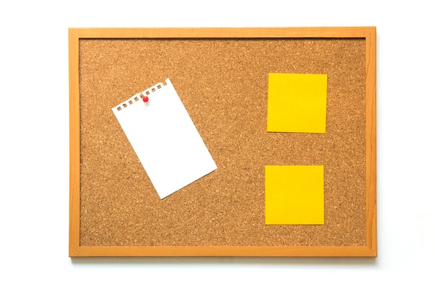Cork board with bank paper and yellow note on white background Premium Photo