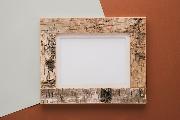 Cork frame on bicolor background Free Photo