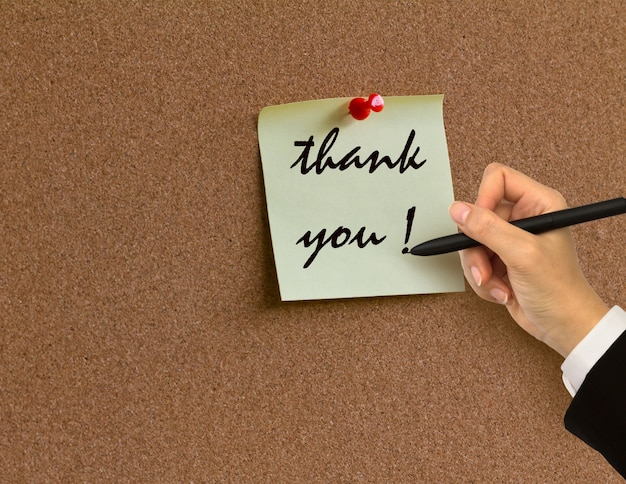 Corkboard with a thanks note Free Photo