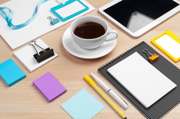 Corporate identity design template on wooden desk close up Premium Photo