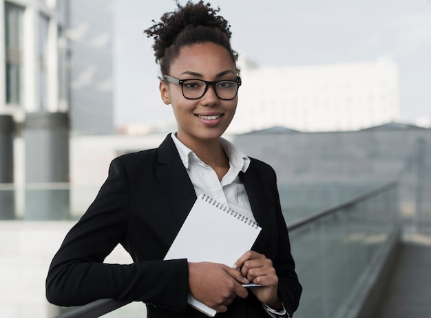 Corporate woman holding notepad Free Photo