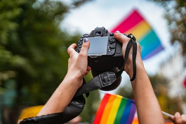 Correspondent takes photo during the gay pride parade Free Photo