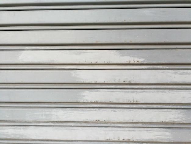 Corrugated metal steel door background and texture surface. Premium Photo