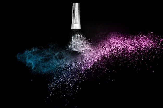 Cosmetic brush with purple and blue ocean cosmetic powder spreading Premium Photo