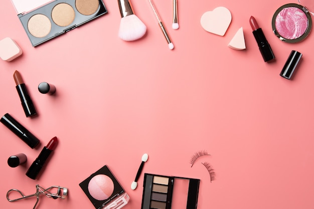 Cosmetic make up flat lay pink background copy space text beauty Premium Photo