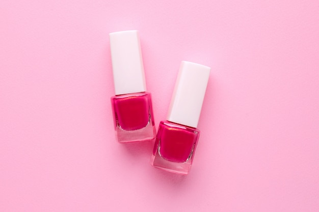 Cosmetic nail polishes pink color on pink Premium Photo