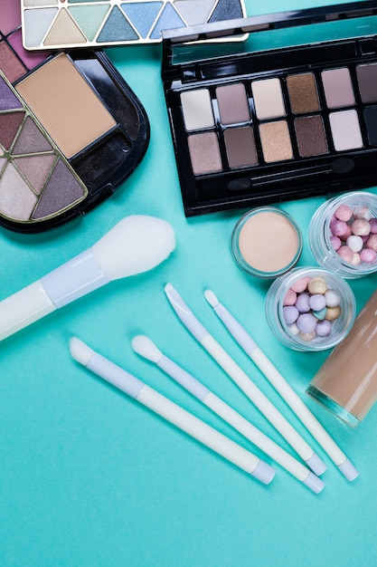 Cosmetics on blue workplace. top view Premium Photo