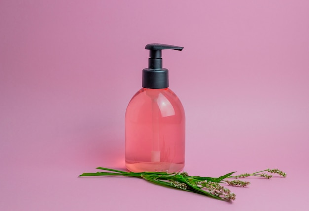 Cosmetics on pink. minimalism. skincare. Premium Photo