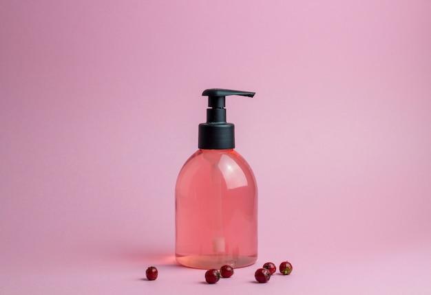 Cosmetics on pink. minimalism. skincare. Premium Photo