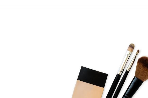 Cosmetics, tube of foundation and brushes Premium Photo