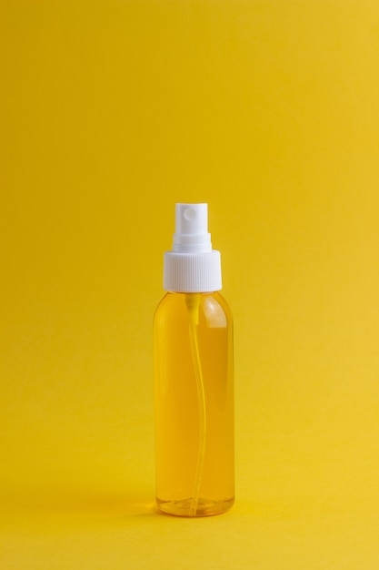 Cosmetics on yellow. minimalism. skincare. Premium Photo