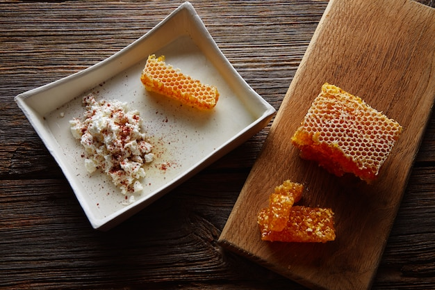 Cottage cheese curd with honey honeycomb Premium Photo