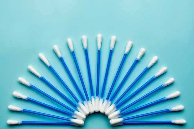 Cotton buds on a blue background. Premium Photo