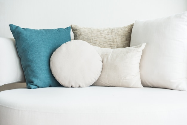 Couch with cushions and a blue Free Photo