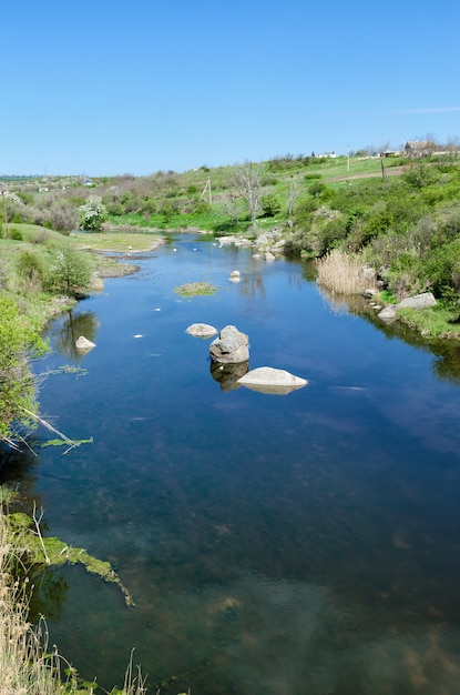 Countryside river landscape in early spring season. Premium Photo