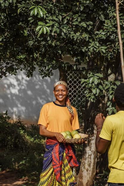 Countryside woman holding fresh fruits Free Photo