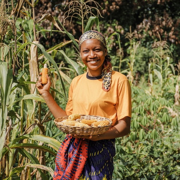 Countryside worker posing with corn Free Photo