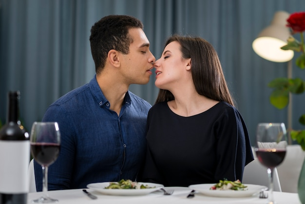Couple almost kissing at romantic dinner Free Photo