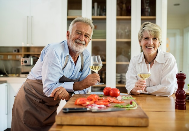 Couple are cooking in the kitchen together Free Photo