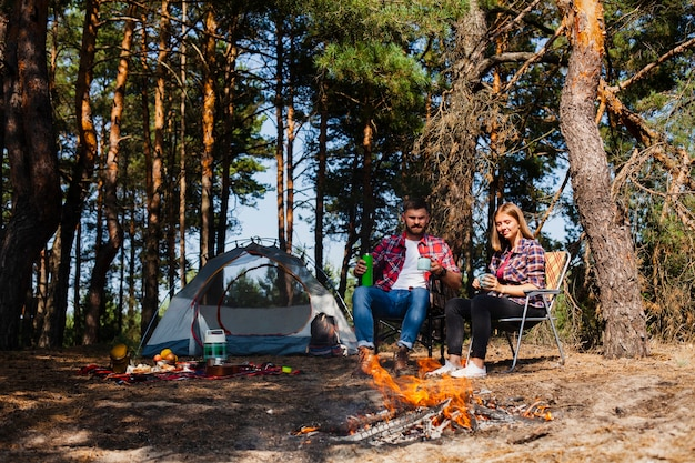 Couple camping and relaxing moment Free Photo
