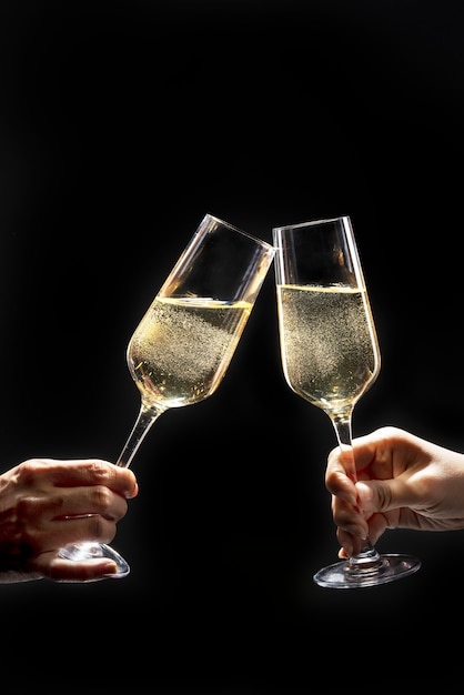 Couple celebrating with champagne on dark Free Photo
