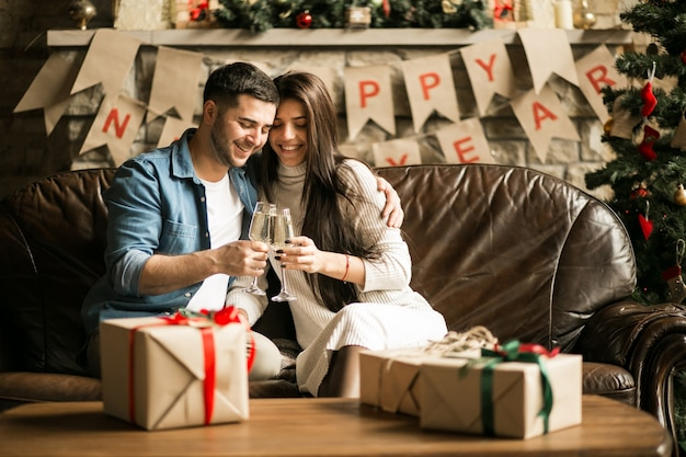Couple on christmas with champaign Free Photo